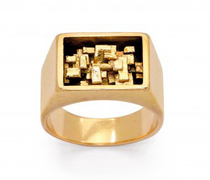 18-karat gold ring decorated with a cluster of tiny ingots by Karl Stittgen.
