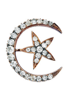 14-karat gold crescent moon and star brooch, with old mind- and old European-cut diamonds. Circa 1900.