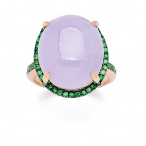 A lavender jadeite cabochon ring, with contrasting deep-green tsavorite garnet trim.