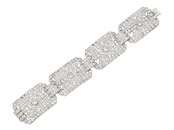 Art deco diamond and platinum multi-panel bracelet, with pierced floral and foliage design from Henri Lyon. French assay mark, circa 1920