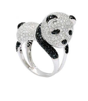 A baby panda pavé-set with white and black diamonds atop 18-karat white gold.